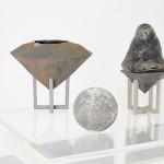 Iron Moon / Iron Diamond / Lava Plug / Cast Iron, Acrylic glass, Volcanic glass, Blacken plaster, Valchromat / Lathwood